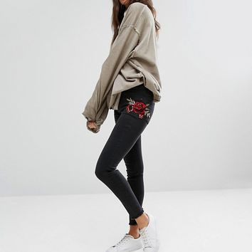 New Look Embroidered Patch Skinny Jeans at asos.com