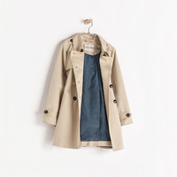 Buttoned trenchcoat