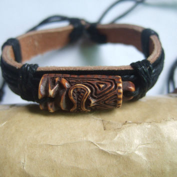 A Brown Tiki Man Charm Leather Bracelet
