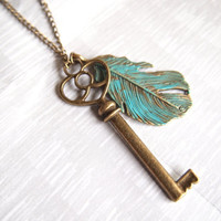 Blue teal feather key charm necklace, long antique brass chain, patina, skeleton key