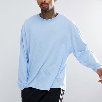 ASOS Oversized Long Sleeve T-Shirt With Cuffs In Blue at asos.com