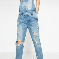 SLIM DENIM DUNGAREES WITH RIPS