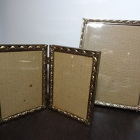 Vintage 5 x 7 Bi-fold and 8 x 10 Footed Gold Tone Picture Frames with a Scalloped Floral Banner Design - Art Deco/Hollywood Regency