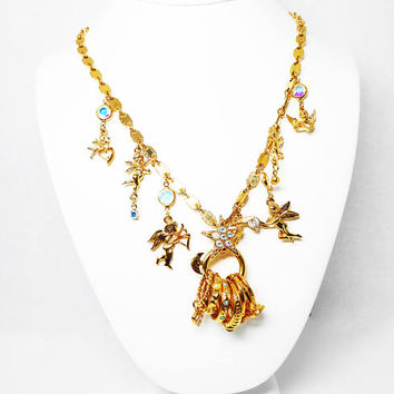 Kirks Folly Cherubs & Rings Charm Necklace - Gold Tone with AB Rhinestones - Dangline Rings, Crystals, Hearts, Cupid Charms Vintage 1990s