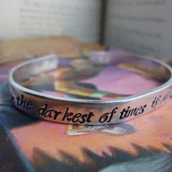 happiness can be found, even in the darkest of times, if one only remembers to turn on the light Albus Dumbledore Quote Silver Bracelet