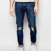 ASOS Skinny Jeans In Tinted Dark Wash With Rips at asos.com