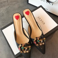 GUCCI Metallic leather slipper with crystal Double G
