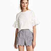 H&M Top with Ruffled Sleeves $17.99