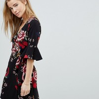 Girls On Film Floral Wrap Dress With Fluted Sleeve at asos.com