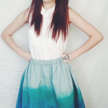 Unique hand painted ombre blue skirt with elastic band. Available in two sizes