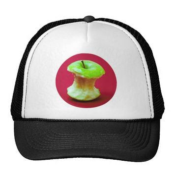 Green apple on red background trucker hat