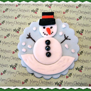 Cute little Christmas Snowman on Blue background. Fondant Cupcake Toppers. 12 (1 dozen) cupcake toppers.