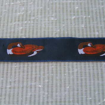 Duck Jacquard Ribbon on Navy Blue Taffeta like Ribbon. Brown Duck with white feathers, a beautiful ribbon.