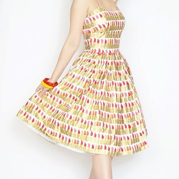 Chelsea Dress in white with gold & red lipstick print