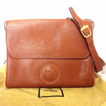 Vintage FENDI brown epi leather messenger bag, shoulder purse with iconic Janus medallion embossed motif at front. Unisex. Rare bag.