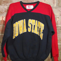 Vintage collectible Iowa State sweatshirt. Size Large and made by Dodger in the USA. 50% cotton and 50 polyester. Sweatshirt is red and