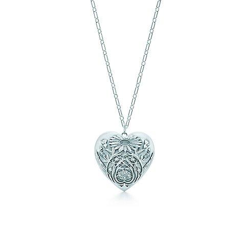 Tiffany & Co. -  Ziegfeld Collection daisy locket in sterling silver on a chain,  large.