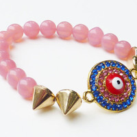 Evil Eye Beaded Bracelet Made with Milky Petal Pink Glass Beads and Gold Spikes