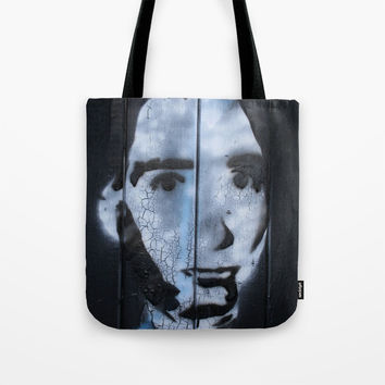 Head on a wall Tote Bag by g-man
