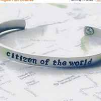 Labor Day Sale citizen of the world/ planet world hand stamped inside  1/4 wide aluminum bracelet, wanderer, adventurous