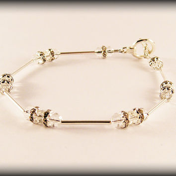 White Dragon bracelet .. Glass bead, rhinestone spacer and silver-plated tube bead bracelet with a toggle clasp.