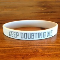 """Keep Doubting Me."" White wristband... Ink Injected Premium. from The Football Life™"