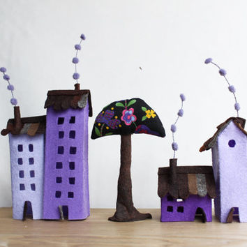 Four lilac buildings of felt, with a tree. Miniature. Decoration.