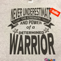 On Sale: Never Underestimate The Strength and Power of a Determined Warrior Sports Gray Shirt (FREE SHIPPING in U.S)