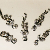 Bollywood Silver Swirl & Curved  Bindi with Crystal with Black Background.