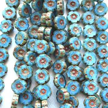25 8mm Czech glass flower beads, light marbled blue with brick red picasso accents, table cut, carved Hawaiian flower beads C66101