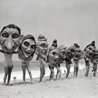 Women Holding Giant Masks Photographic Print by Bettmann at Art.com