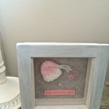 New baby gift for baby girl. Unique baby gift framed art nursery decor - pink with knitted baby hat, miniature dummy and pram - small size