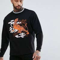 ASOS Oversized Sweatshirt With Tiger Print And Tipped Ribs at asos.com
