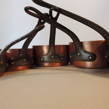 Copper pots, sauce pans, with cast iron handles, a set of 5 vintage french professional cooking pots