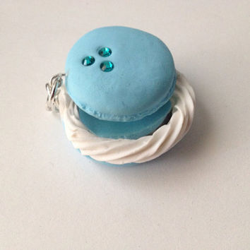Blue Moon macaroon charm with a mirror inside.