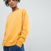 ASOS DESIGN oversized sweatshirt with double neck in yellow at asos.com