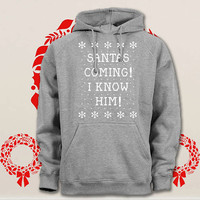 santas coming i know him hoodie. pullover. sweatshirt. sweater. color black white green blue gray red for size s - 3xl