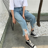 TATTERED LEG DENIMS