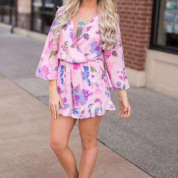 Here Comes The Fun Bell Sleeve Ruffle Detail Surplice Floral Romper (Pink)