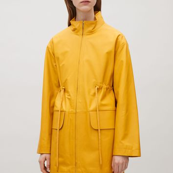 Rubberised leather coat - Yellow - Coats & Jackets - COS US