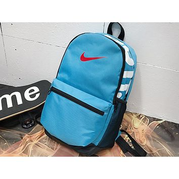 NIKE sells casual men's and women's shopping bags with fashionable printed stitching backpacks Sky Blue