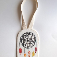 Modern dreamcatcher wall hanging or Christmas ornament hand embroidered geometric design with rust red, burnt orange, mustard yellow colors