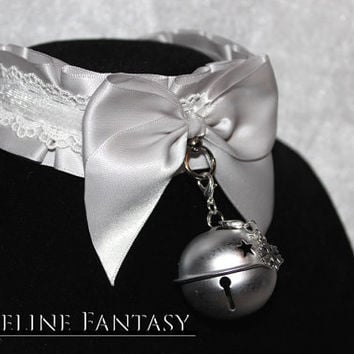 kittenplay petplay collar with silver base, lace, glitter lining and big silver jingle bell with tiny snowflake charm