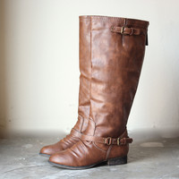 buckled down tall zippered riding boots tan