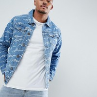boohooMAN denim jacket with man print in blue wash at asos.com