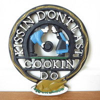 Kissin Don't Last Cookin Do, Vintage novelty cast metal trivet in great conditon