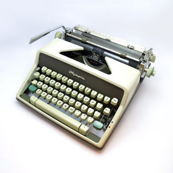 "1960s Working Manual Portable ""Olympia SM 7"" Typewriter in Good Cosmetic Condition. Made in West Germany. Carry Case Included."