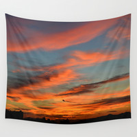 The sky is on fire Wall Tapestry by Haroulita | Society6