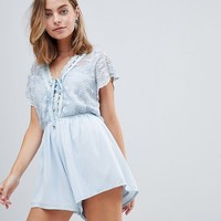 Sisters Of The Tribe Petite Deep V Playsuit With Lace Panel at asos.com