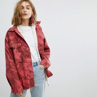 Reclaimed Vintage Revived Overdyed Military Jacket In Red Camo at asos.com